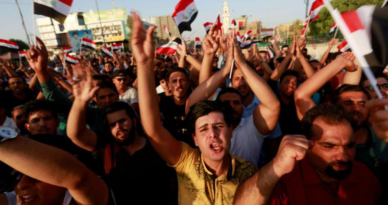 Iraqis protest over poor public services in the city of Najaf, on July 27. (Reuters)