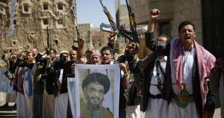 Shia rebels, known as Houthis, hold a poster of Hezbollah leader Sheikh Hassan Nasrallah during a rally in support of Hezbollah, in Sana'a, Yemen. (AP)