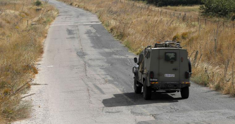 A picture taken on July 20, 2018 in the Israeli-annexed Golan Heights shows an Israeli jeep patrolling on the border between Israel and Syria. (AFP)