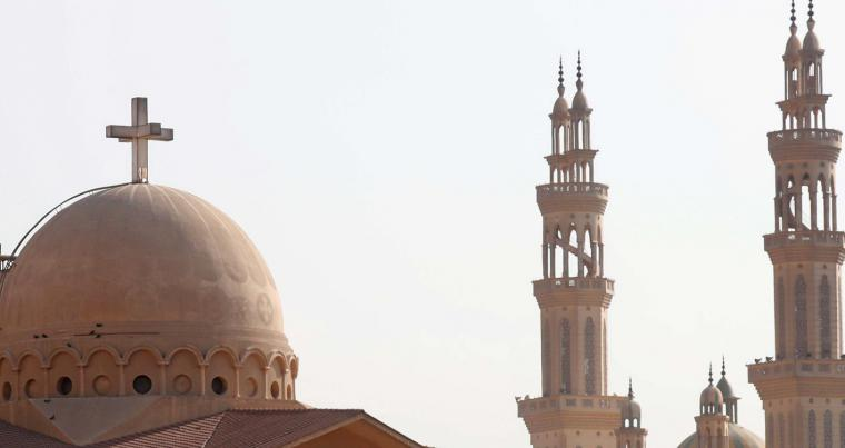 For a peaceful coexistence. Minarets of a mosque and a cross above a church in the El-Marg district of Cairo.                        (Reuters)