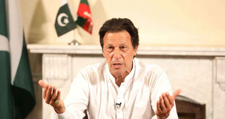 Prime Minister-designate Imran Khan delivers a speech at his residence in Islamabad , on July 26. (AFP)