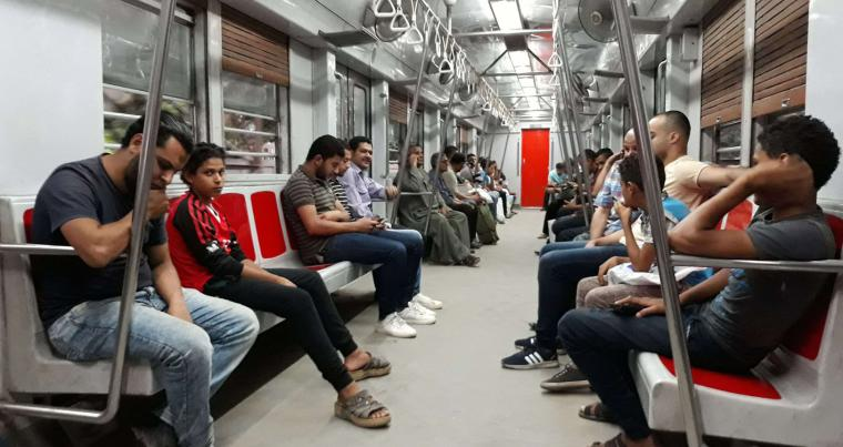 People ride a train at a metro station in Cairo. (AFP)