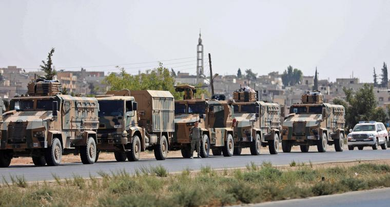 Turkish forces are seen in a convoy on a main highway between Damascus and Aleppo, near the town of Saraqib in Syria's northern Idlib province, on August 29, 2018. (AFP)