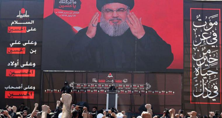 Lebanon's Hezbollah leader Hassan Nasrallah gestures as he addresses his supporters via a screen in Beirut, on September 20. (Reuters)