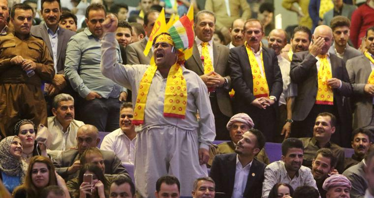 Supporters of Former Iraqi Kurdistan region's President Masoud Barzani, shout slogans ahead of regional elections in Erbil, Iraq September 11, 2018. (Reuters)