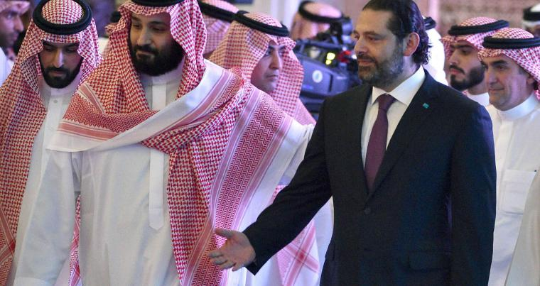 Saudi Crown Prince Mohammed bin Salman (L) arrives with former Lebanese Prime Minister Saad al-Hariri to attend the Future Investment Initiative FII conference in the Saudi capital Riyadh on October 24, 2018. (AP)