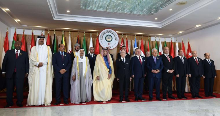 Arab leaders pose for a group photograph during the 30th Arab League summit in the Tunisian capital Tunis on March 31. (AFP)