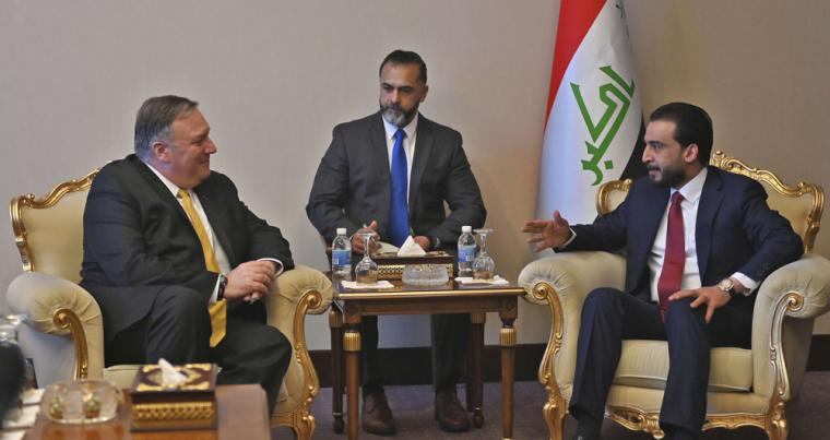 Iraqi Parliament Speaker Mohammed al-Halbusi meets with US Secretary of State Mike Pompeo, left, in Baghdad, last January. (AP)