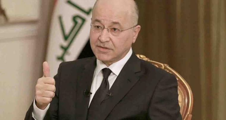 Iraq's President Barham Salih speaks during an interview. (AP)
