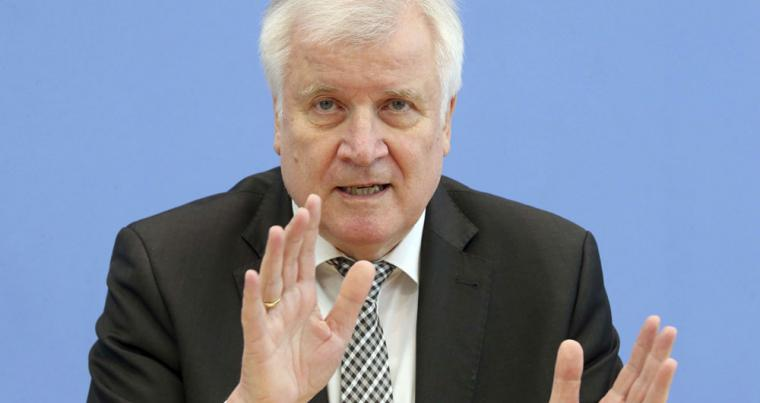 German Interior minister Horst Seehofer gestures as he attends a news conference in Berlin, May 14. (AP)
