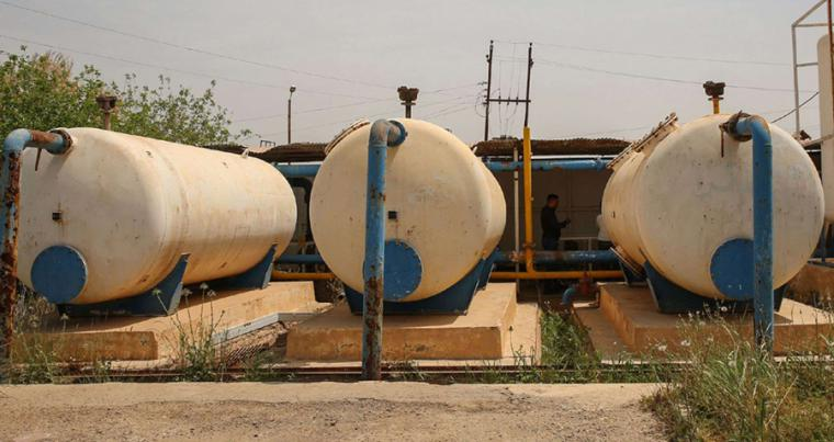 Rusted cisterns are seen at the Al-Mashahada pumping station north of Iraq's capital Baghdad, April 16. (AFP)