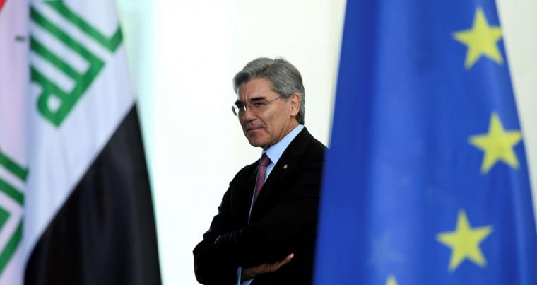 Siemens CEO Joe Kaeser attends a signing ceremony ahead of a news conference with German Chancellor Angela Merkel and Iraqi Prime Minister Adil Abdul-Mahdi at the Chancellery in Berlin, April 30. (Reuters)