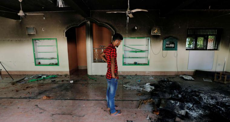 A Muslim man looks at damages inside a mosque after a mob attack in Kottampitiya, Sri Lanka May 14. (Reuters)