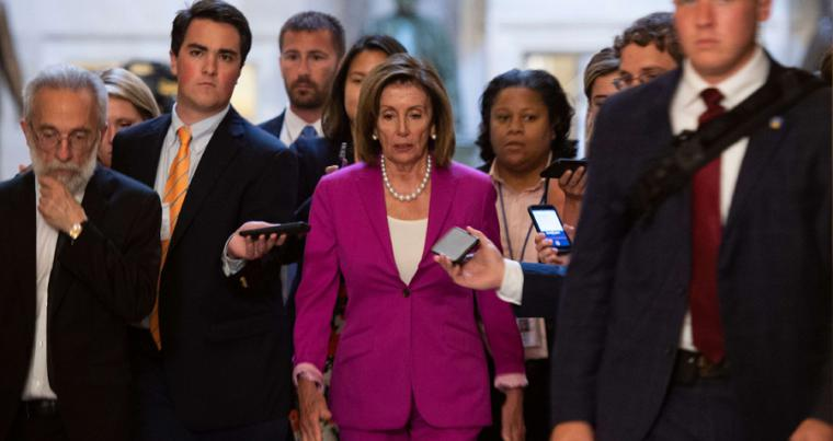"US speaker of the House Nancy Pelosi (C) walks with reporters before the House of Representatives passed a resolution condemning US President Donald Trump for his ""racist comments"" in Washington, July 16. (AFP)"