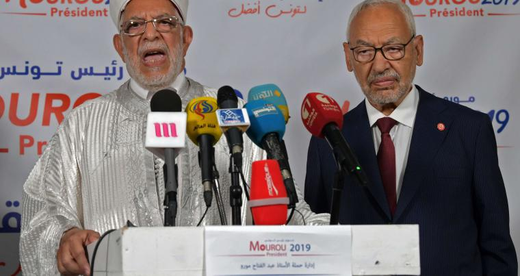 Ennahdha's presidential candidate Abdelfattah Mourou (L) and Ennahdha Party leader Rached Ghannouchi give a joint press conference in Tunis on September 17. (AFP)
