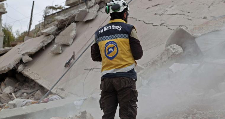 A member of the Syrian Civil Defense (White Helmets) looks at the rubble of a building following a reported Russian airstrike on Marayan village in the north-western Idlib, november 22. (AFP)