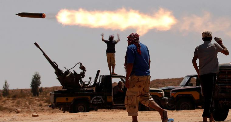 Anti-Gaddafi fighters fire a multiple rocket launcher near Sirte, previously one of Muammar Gaddafi's last remaining strongholds in Libya, September 24, 2011. (Reuters)