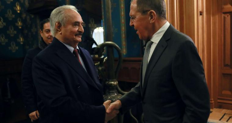 Commander of the Libyan National Army (LNA) Khalifa Haftar shakes hands with Russian Foreign Minister Sergei Lavrov before talks in Moscow, January 13. (Ministry of Foreign Affairs of the Russian Federation via Reuters)
