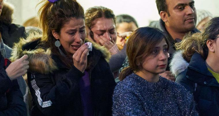 A woman weeps during a service at Western University in London, Ontario on January 8, 2020 for the four graduate students who were killed in a plane crash in Iran. (AFP)