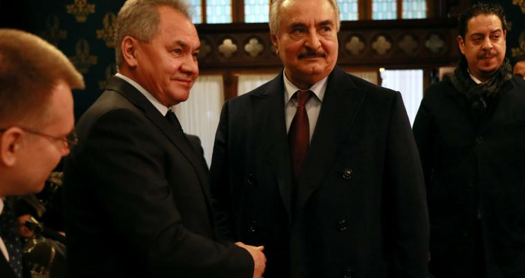 Commander of the Libyan National Army (LNA) Khalifa Haftar shakes hands with Russian Defence Minister Sergei Shoigu before talks in Moscow, Russia January 13, 2020. (Reuters)