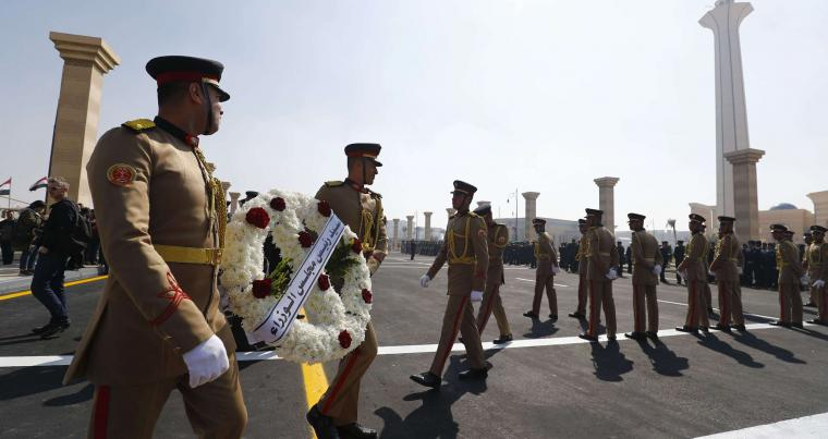 Egyptian guards carry a wreath honouring Egypt's former president Hosni Mubarak outside Cairo's Mosheer Tantawy mosque in the eastern outskirts of the Egyptian capital on February 26, 2020. (AFP)