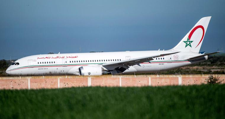 A February 2020 file picture shows a Royal Air Maroc (RAM) aircraft landing at Morocco's Benslimane airport carrying repatriated Moroccan citizens from China's Wuhan province following the coronavirus outbreak. (AFP)