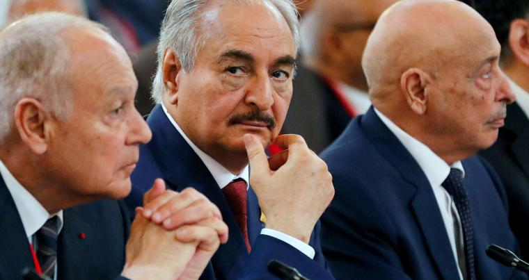 A file picture shows LNA's commander Khalifa Haftar (C) and parliamentary speaker Aguila Saleh  (R) attending an international conference in Paris, in May 2018. (Reuters)