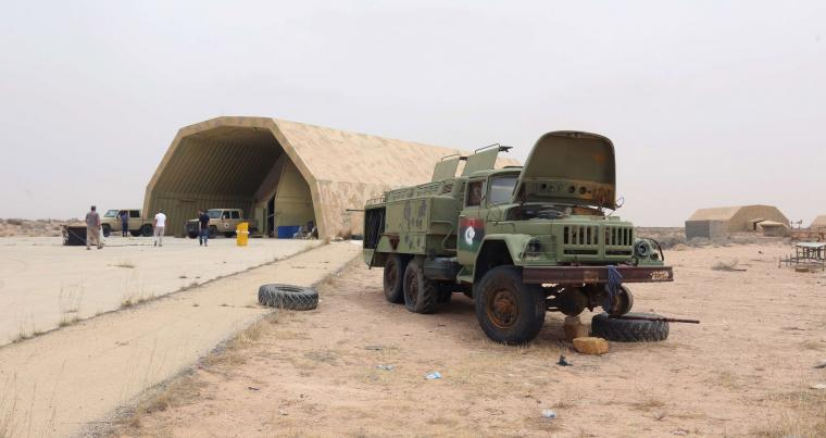 Vehicles outside a hangar at Al-Watiya airbase, which was seized by forces loyal to Libya's Government of National Accord (GNA), southwest of the capital Tripoli, on May 18, 2020. (AFP)