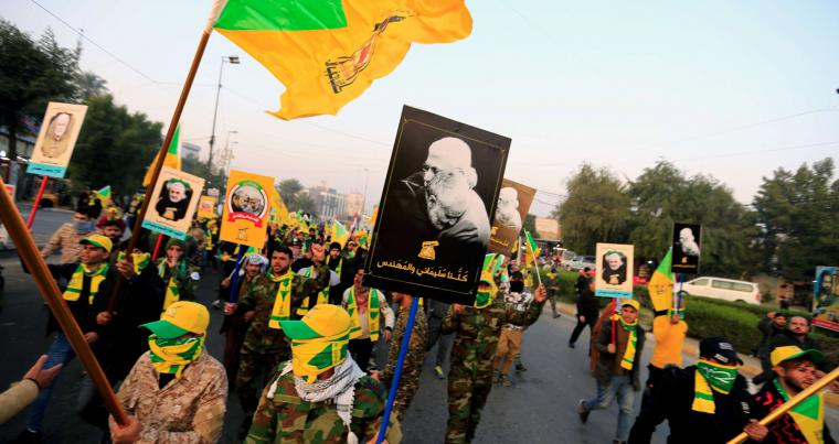 Kataib Hezbollah Iraqi militia gather ahead of the funeral of the Iraqi militia commander Abu Mahdi al-Muhandis, who was killed in an air strike at Baghdad airport, last January. (REUTERS)