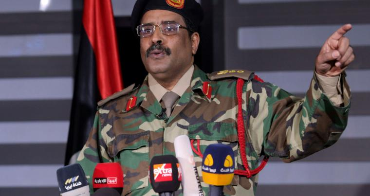 Pre-planned moves. A file picture of Ahmed al-Mismari, spokesman for the eastern-based Libyan National Army (LNA), speaking at a press conference. (AFP)