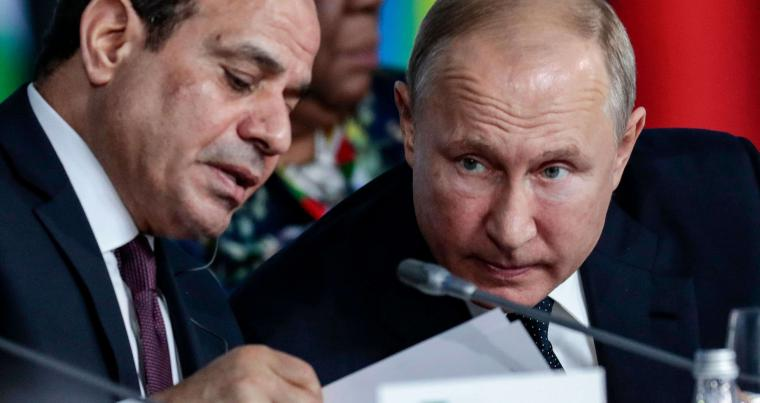 A 2019 file photo of Egypt's President Abdel Fattah al-Sisi (L) talking to Russia's President Vladimir Putin. (AFP)