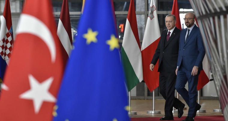 A file picture shows Turkish President Recep Tayyip Erdogan, left, walking with European Council President Charles Michel as he arrives at the European Council building in Brussels.  (AP)