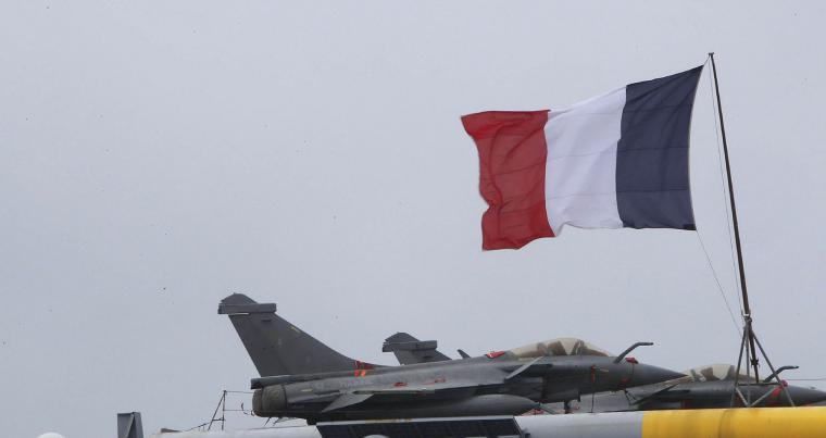 French Rafale warplanes on the deck of the aircraft carrier Charles de Gaulle, docked at Cyprus' main port of Limasso. (AP)