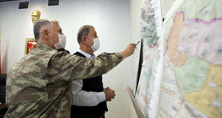 Turkish Defence Minister Hulusi Akar (R) looking at a map with members of the Turkish Armed Forces Command in Ankara. (AFP)