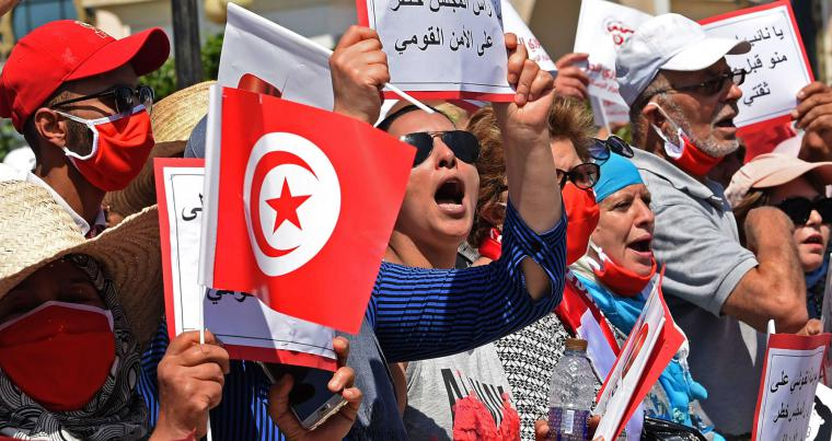 Supporters of the Free Destourian Party (PDL) rally against Parliament Speaker Rached Ghannouchi outside the Tunisian parliament in Tunis on June 3. (AFP)