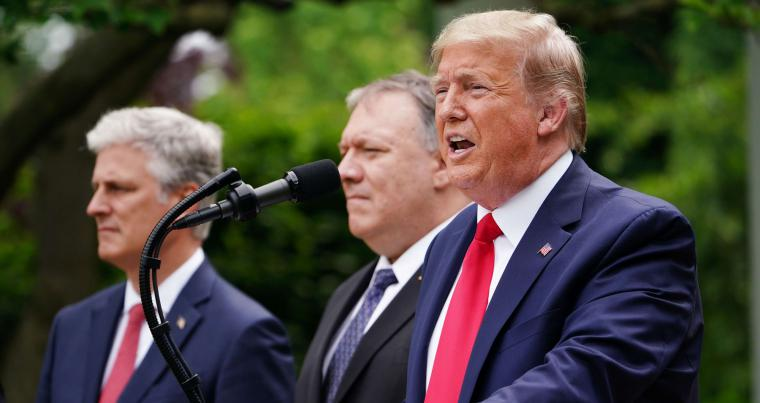 US National Security Advisor Robert O'Brien (L), and Secretary of State Mike Pompeo (C) look on as US President Donald Trump speaks during a press conference in Washington. (AFP)
