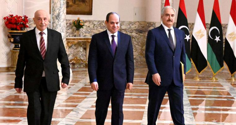 Egyptian President Abdel Fattah al-Sisi (C), Libyan commander Khalifa Haftar (R) and the Libyan Parliament speaker Aguila Saleh arriving for a joint press conference in Cairo, June 6. (AFP)