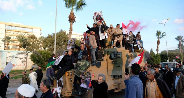 A file picture shows supporters of Libyan National Army (LNA) celebrate on top of a captured Turkish military armoured vehicle, last January in Benghazi. (Reuters)