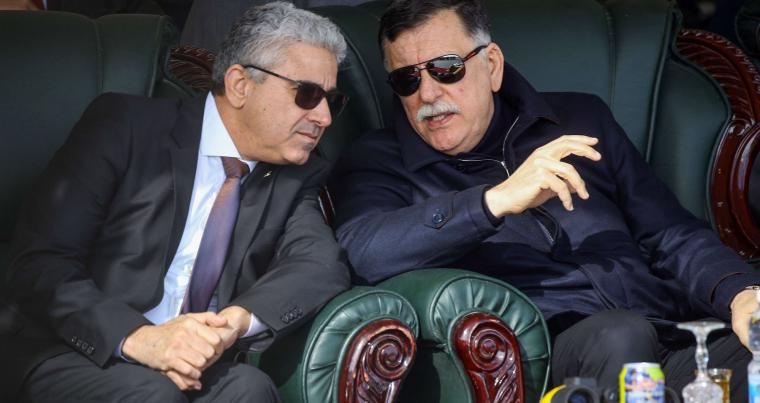 A file picture shows Libya's GNA Prime Minister Fayez al-Sarraj (R) speaking with Interior Minister Fathi Bashagha (L) in Tripoli. (AFP)