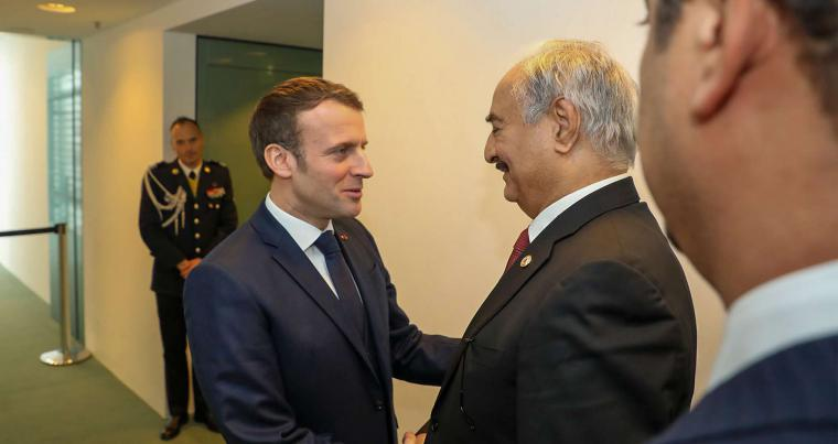 Khalika Haftar (2nd-R) greeting with French President Emmanuel Macron (C) in the German capital Berlin. January 16, 2020. (AFP)