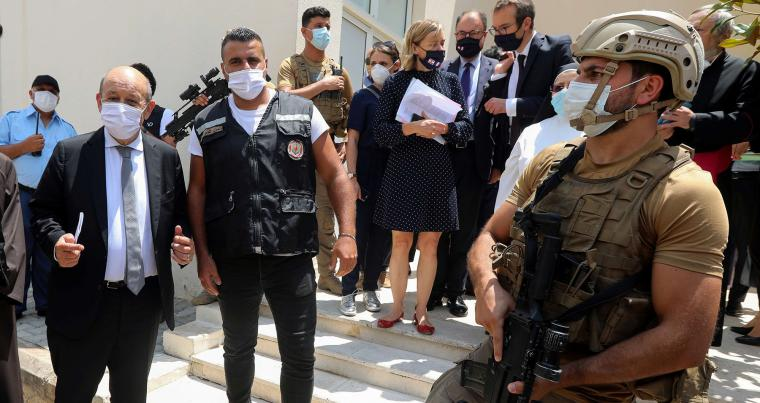Lebanese security forces stand guard as French Foreign Affairs Minister Jean-Yves Le Drian leaves a school in Mechref, Lebanon, July 24. (REUTERS)