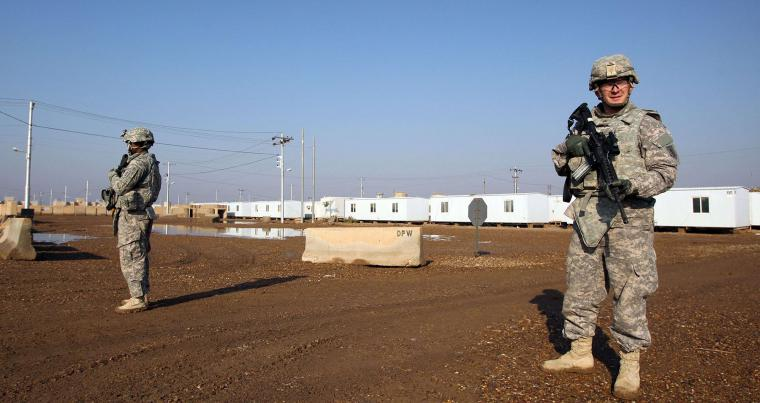 US soldiers stand guard at the Taji base complex which hosts Iraqi and US troops, north of Baghdad. (AFP)