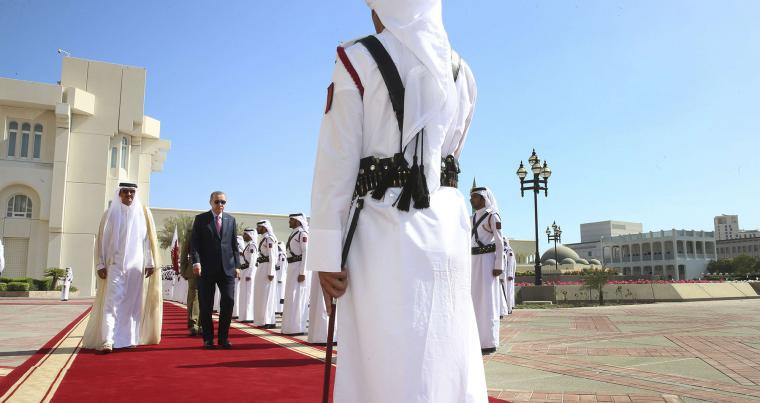 A file picture of Turkey's President Recep Tayyip Erdogan, second left, walkin with the Emir of Qatar Sheikh Tamim bin Hamad Al Thani in Doha, in 2017. (AP)