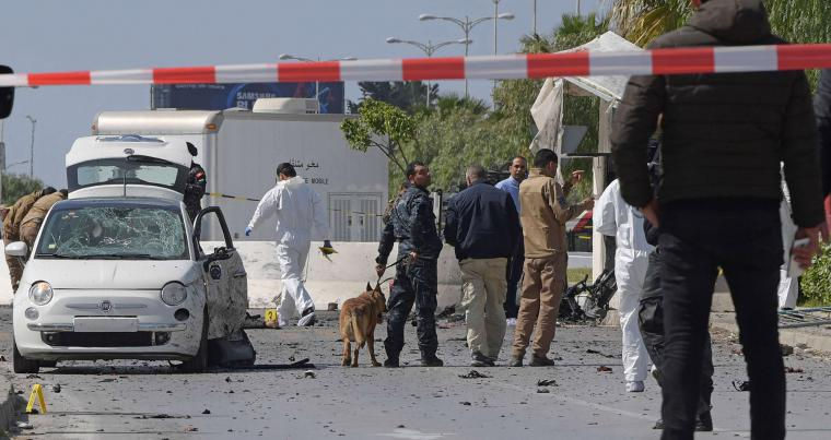Police and forensic experts inspect the scene of an explosion near the US Embassy in the Tunisian capital Tunis on March 6, 2020. (AFP)