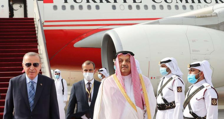 Qatari Deputy Prime Minister and Minister of State for Defence Affairs Khalid bin Mohammad al-Attiyah welcomes Turkish President Recep Tayyip Erdogan (L) upon his arrival in Doha. (AFP)