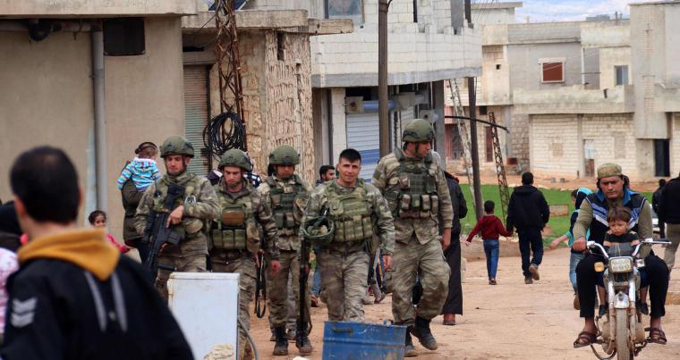 Turkish soldiers patrol a street in the Syrian village of Ram Hamdan, north of the city of Idlib. (AFP)