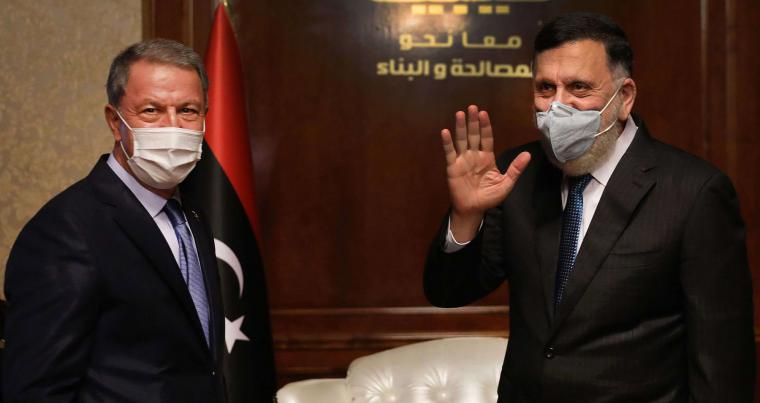 Fayez al-Sarraj (R), Prime Minister of Libya's Government of National Accord receives Turkish Defense Minister Hulusi Akar in the Libyan capital Tripoli, July 3. (AFP)
