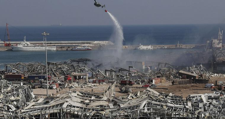 An army helicopter drops water at the scene of Tuesday's massive explosion that hit the seaport of Beirut, Lebanon, August 5. (AP)