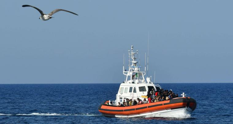An Italian Guardia Costiera (Coast Guard) boat with migrants from Tunisia and Libya arrives in the port of the Italian island of Lampedusa. (AFP)