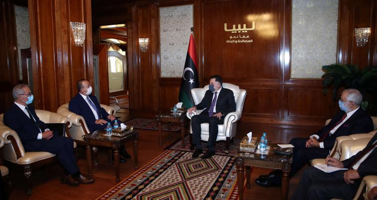 Turkish Foreign Minister Mevlut Cavusoglu and Malta's Foreign Minister Evarist Bartolo meet with Tripoli-based GNA Prime Minister Fayez al-Sarraj in Tripoli, August 6. (AP)